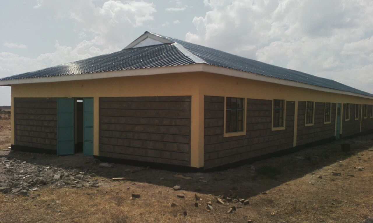 LOIGERO PRIMARY SCHOOL – 4 TOILETS, RAIN CATCHMENT SYSTEM, AND DORMITORY SEPARATION